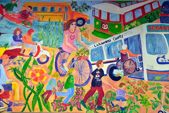A large mural hangs inMaureen McGuigan's office