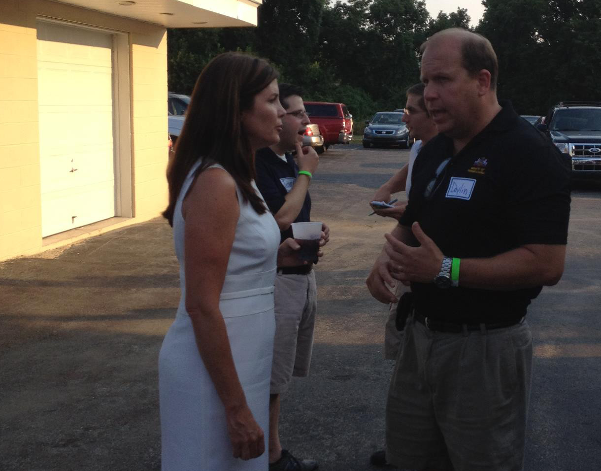 Daylin Leach, right, chats with the state's next Attorney General, Kathleen Kane