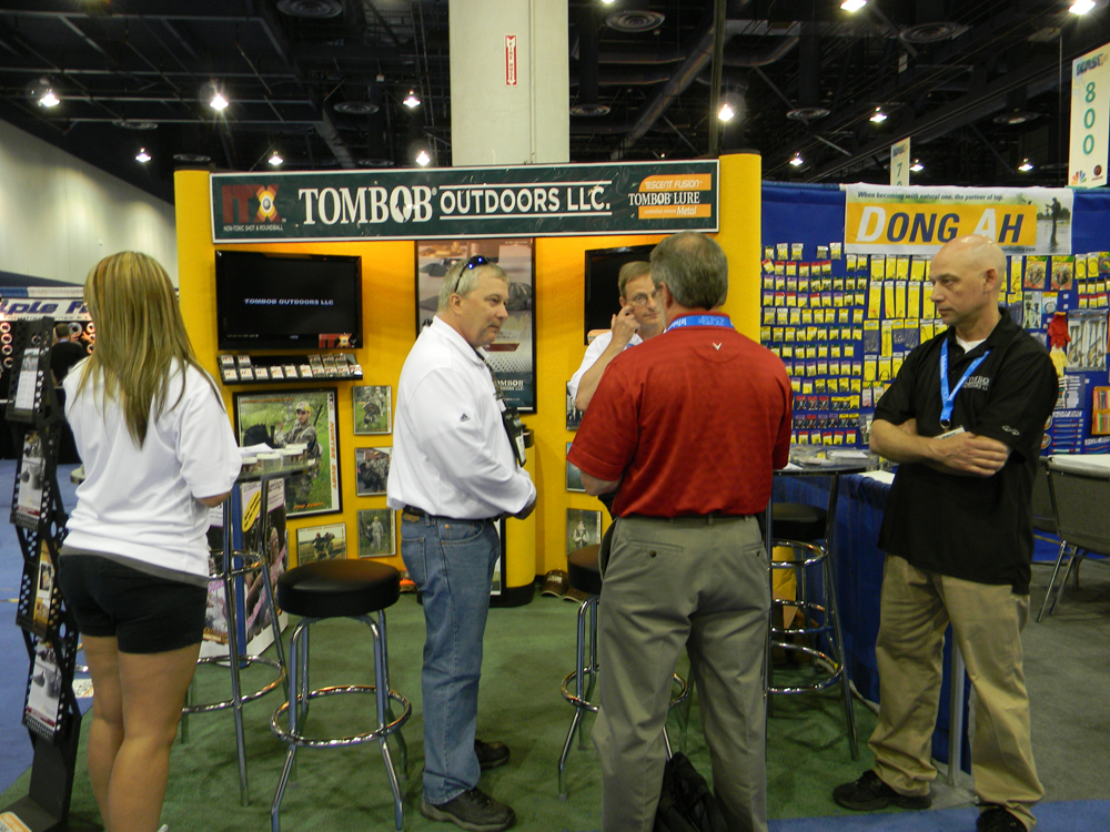 Brad Clinton and Tim and Ivan Smith from CMT and TomBob Outdoors at the ICast fishing trade show in Las Vegas.