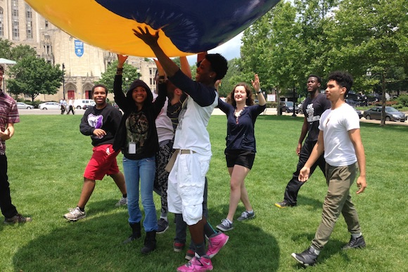 Students playing with a giant ball in Schenley Plaza as part of a lesson with City of Play