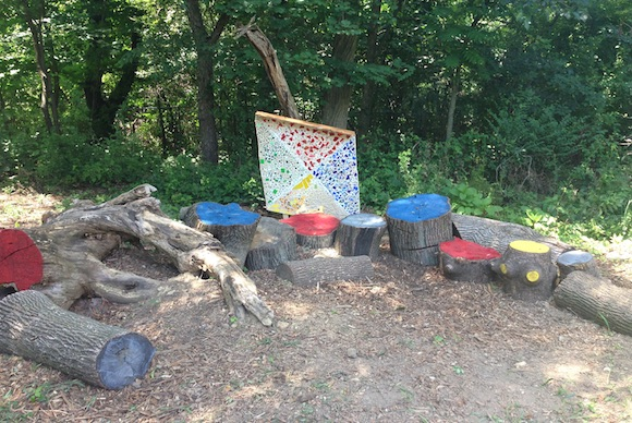 A kite-shaped mosaic and colorful stump area students created to brighten the park