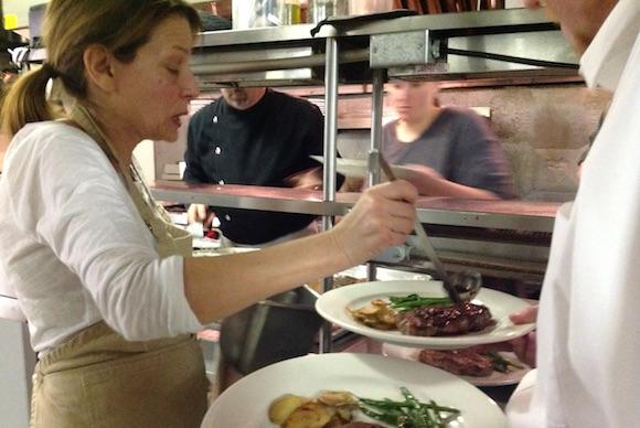 Deb Adams in the kitchen at Gateway Lodge