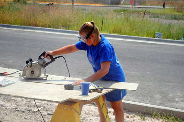 THE AUTHOR VOLUNTEERING WITH HABITAT FOR HUMANITY