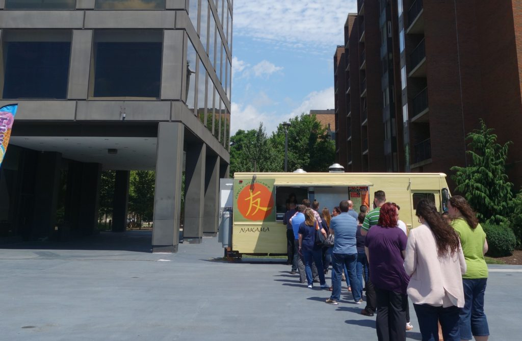A food truck in the plaza at Nova Place